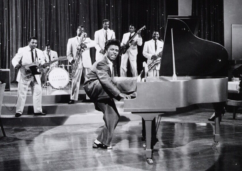 Little Richard, at the piano, and his band, The Upsetters, are shown in the late 1950s in this file photo.