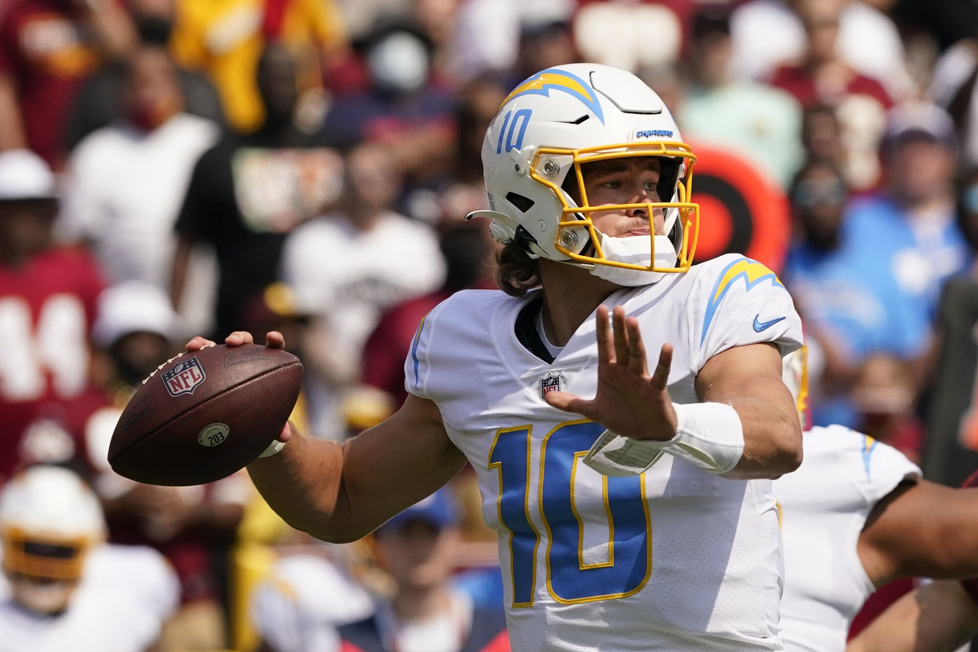 Chargers quarterback Justin Herbert passes against Washington in the first half of Sunday's win.