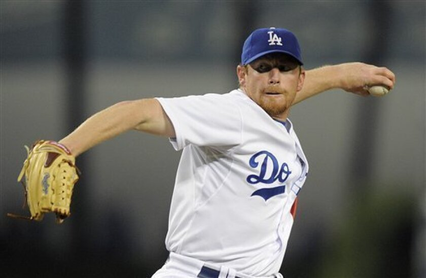 FILE - This is a Sept. 15, 2009, file photo showing Los Angeles Dodgers starting pitcher Randy Wolf throwing against the Pittsburgh Pirates during the first inning of a baseball game in Los Angeles. Randy Wolf and the Milwaukee Brewers have reached a preliminary agreement on a three-year contract worth $27 million to $30 million, a person familiar with the negotiations told The Associated Press, Wednessday Dec. 9, 2009. (AP Photo/Jae C. Hong, File)