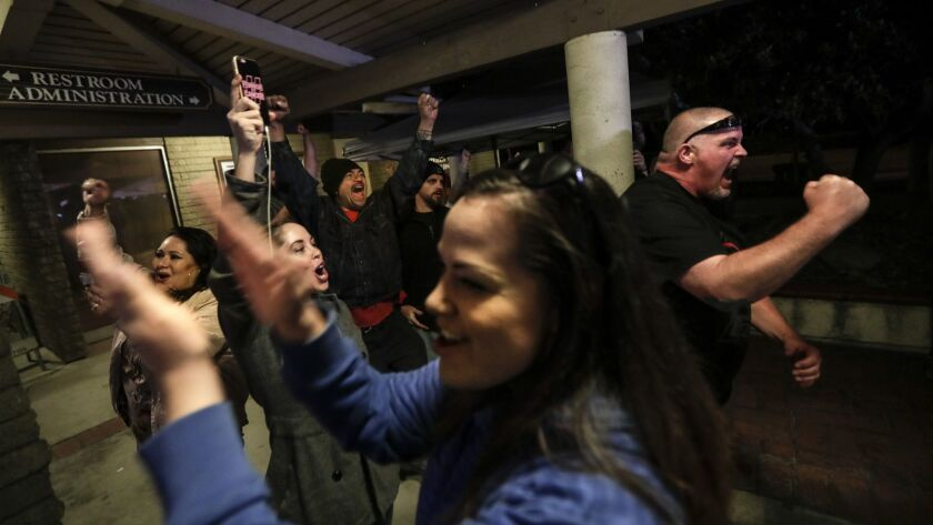 """Spectators cheer the Los Alamitos City Council's vote to oppose California's """"sanctuary"""" state law."""