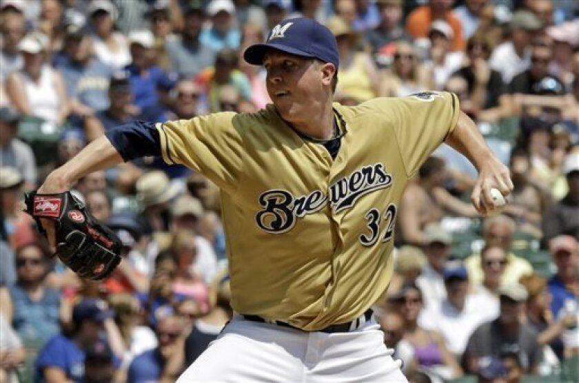 Milwaukee Brewers starting pitcher Tom Gorzelanny throws during the first inning of a baseball game against the New York Mets, Sunday, July 7, 2013, in Milwaukee. (AP Photo/Morry Gash)