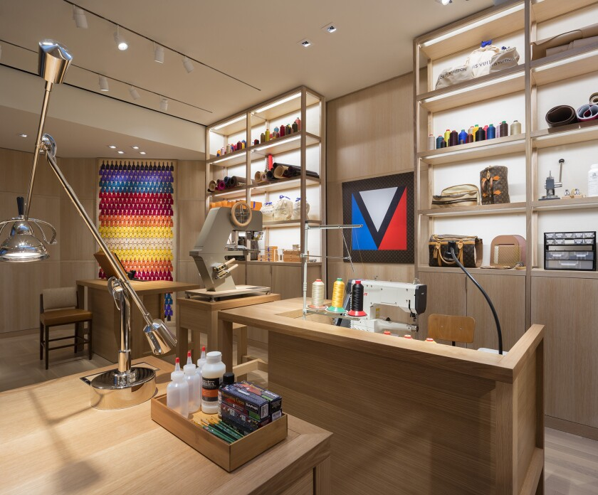 Pictured: In-store atelier where three artisans craft and repair handbags. Louis Vuitton recently r