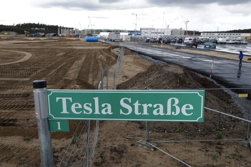 """A street sign reading """"Tesla Street 1"""" in German at the construction site of the Tesla factory near Berlin."""