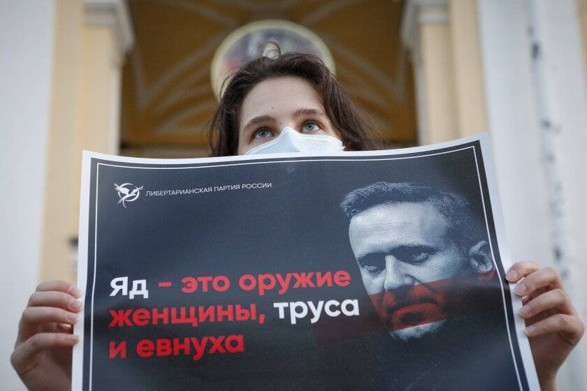 A supporter of Alexei Navalny protests in St. Petersburg, Russia, on Thursday.