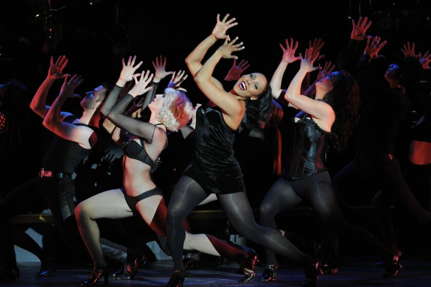 "Kyra Da Costa (front) and the company of San Diego Musical Theatre's ""Chicago."""