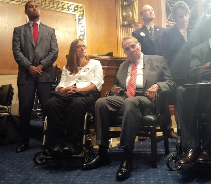 Former Sen. Bob Dole appears at a news conference on Capitol Hill, where he visited to support ratification of the Convention on the Rights of Persons with Disabilities.
