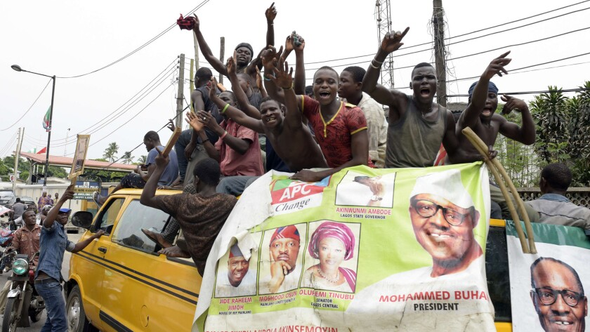 Supporters of newly elected Nigerian President Muhammadu Buhari celebrate in Lagos on Wednesday.