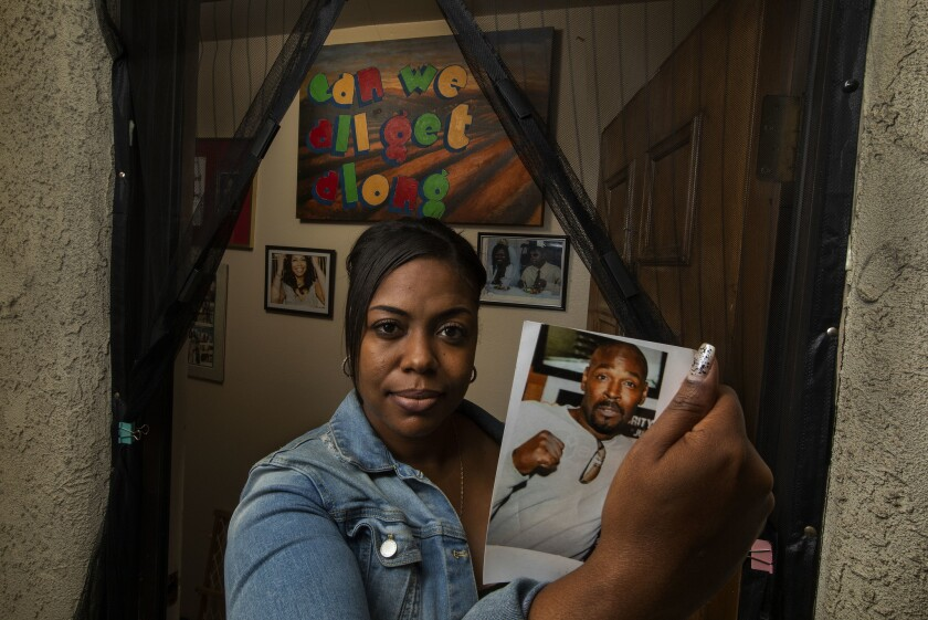 SAN PEDRO, CA-APRIL 26, 2019: Lora King, daughter of Rodney King, holds a photograph of her late fa