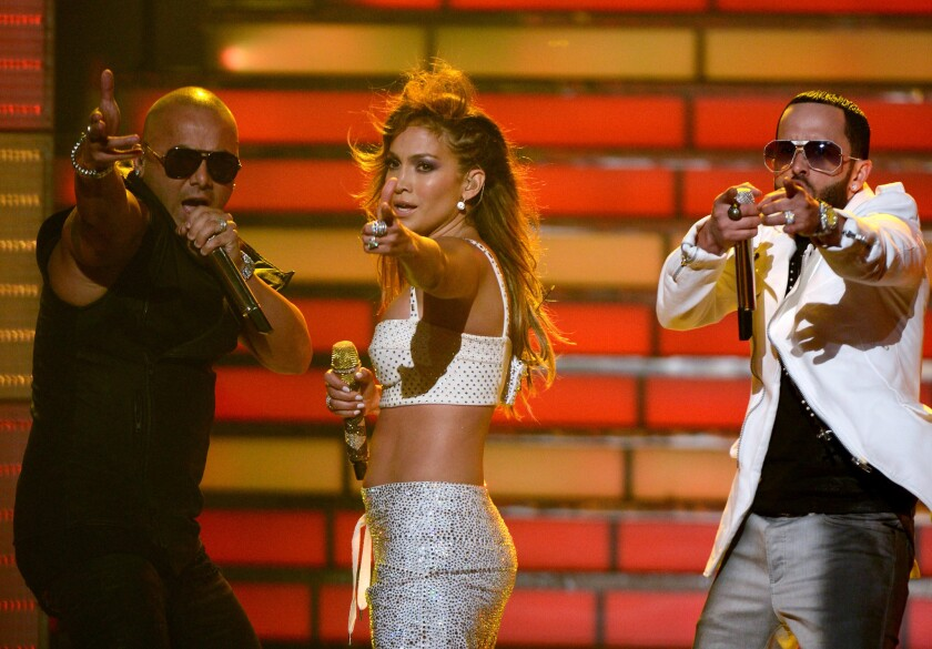 "Jennifer Lopez (C) with Wisin (L) and Yandel of Wisin Y Yandel perform onstage during Fox's ""American Idol 2012"" results show at Nokia Theatre L.A. Live."