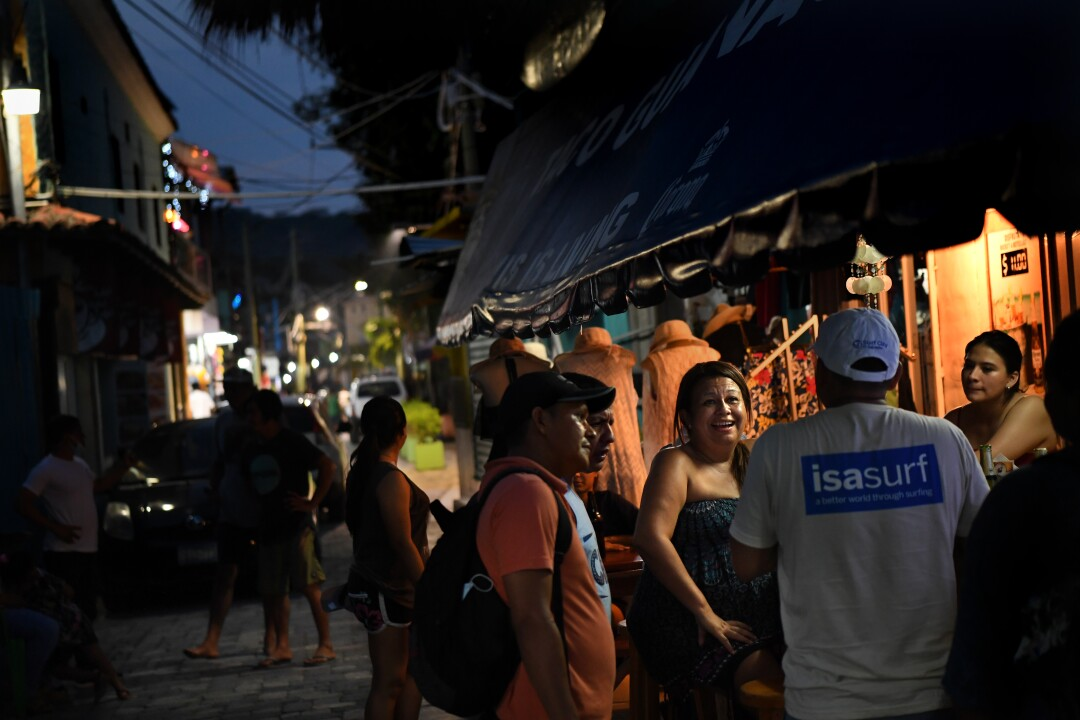 Locals and tourists enjoy the evening at Surf City.