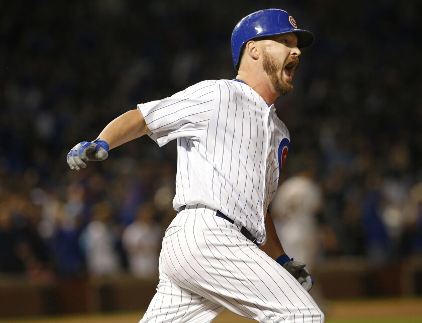 Travis Wood becomes first reliever to homer in playoffs since 1924; Cubs win 5-2