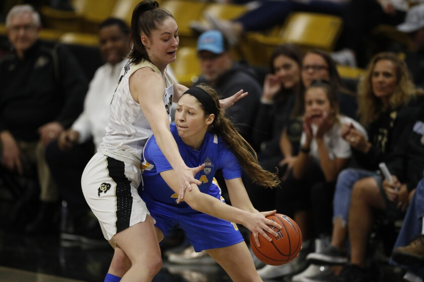 Colorado guard Emma Clarke (3) and UCLA guard Lindsey Corsaro (4) in the second half on Sunday in Boulder, Colo. UCLA won 65-62.