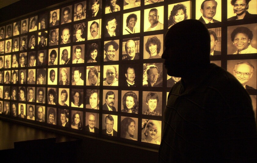Photographs of the 168 victims of the 1995 bombing of the federal building line a wall at the Oklahoma City National Memorial Center.
