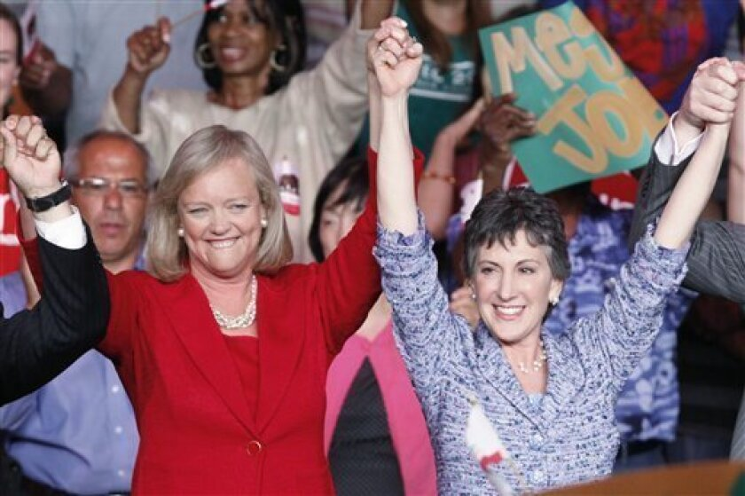 Meg Whitman, left, winner of the Republican nomination for governor of California, and Carly Fiorina, the GOP nominee for the U.S. Senate from California, celebrate at a post-primary election celebration in Anaheim, Calif., Wednesday, June 9, 2010. U.S. Sen. Barbara Boxer says she is used to tough campaigns, so Carly Fiorina won't represent an exception on that front. Still, Fiorina has some things going for her that make her particularly formidable: money, the ability to run as a political outsider and a fired-up conservative base. (AP Photo/Reed Saxon)
