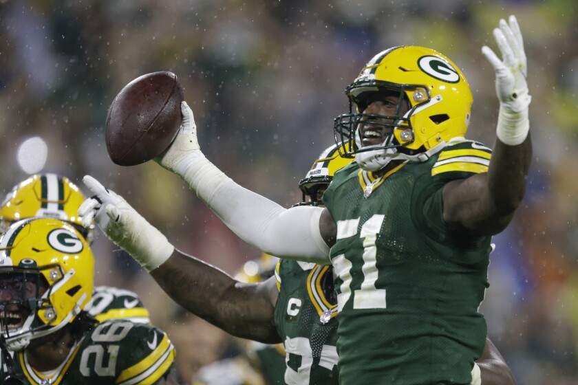 Green Bay Packers' Krys Barnes celebrates a fumble recovery during the second half of an NFL football game against the Detroit Lions Monday, Sept. 20, 2021, in Green Bay, Wis. (AP Photo/Matt Ludtke)