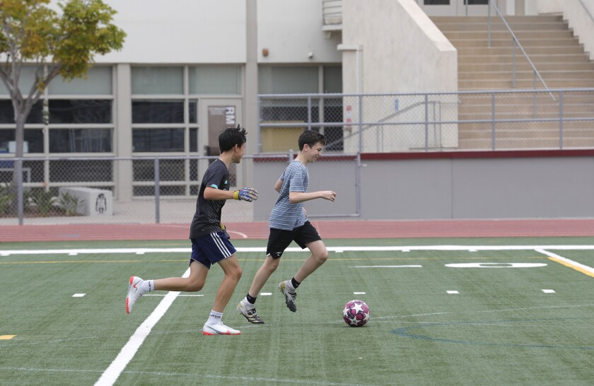 Two students practice soccer at Laguna Beach High School.
