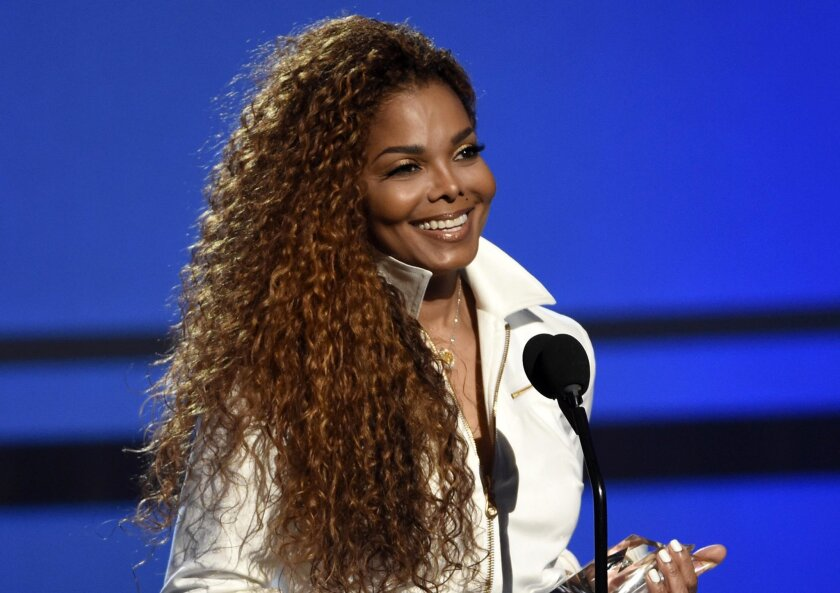 FILE - In this June 28, 2015, file photo, Janet Jackson accepts the ultimate icon: music dance visual award at the BET Awards in Los Angeles. Jackson is being considered for induction next year in the Rock and Roll Hall of Fame. (Photo by Chris Pizzello/Invision/AP, File)