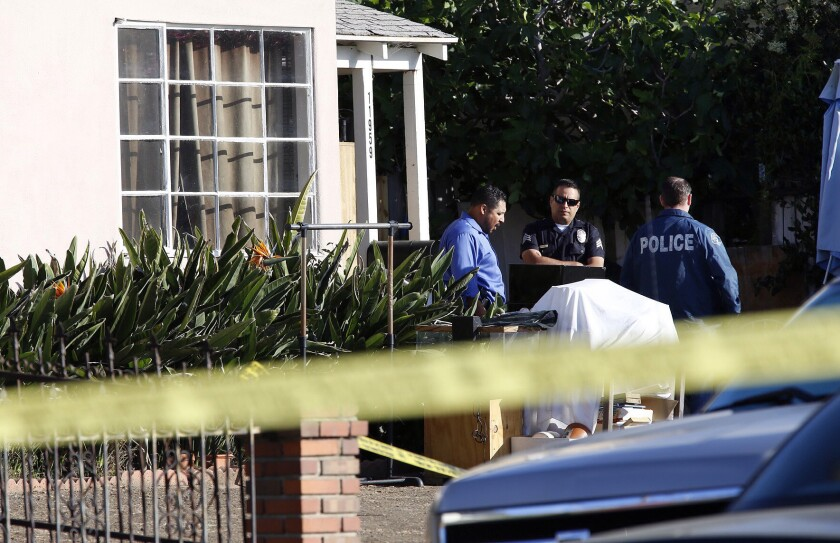 Authorities investigate Monday in the Del Rey neighborhood of Los Angeles after an 8-year-old boy was shot in the head by a stray bullet while he was sleeping late Sunday night.