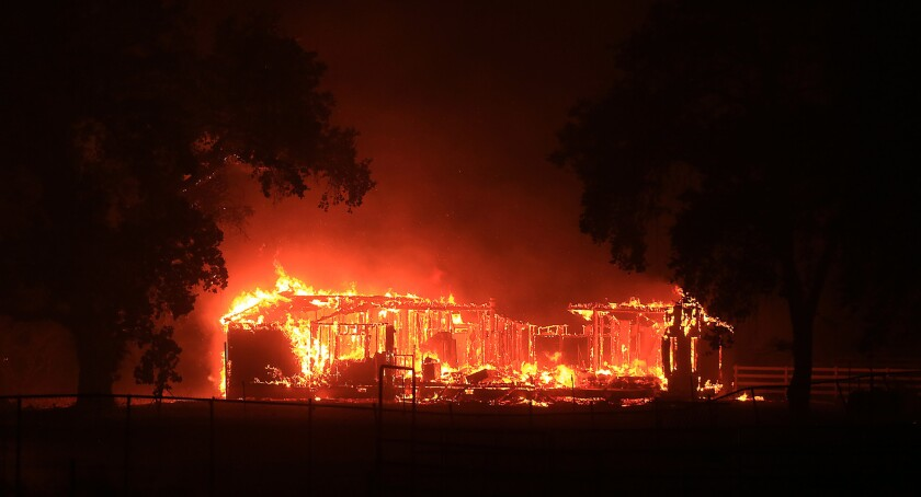 The Valley fire burns a home along Highway 29 in Hidden Valley.
