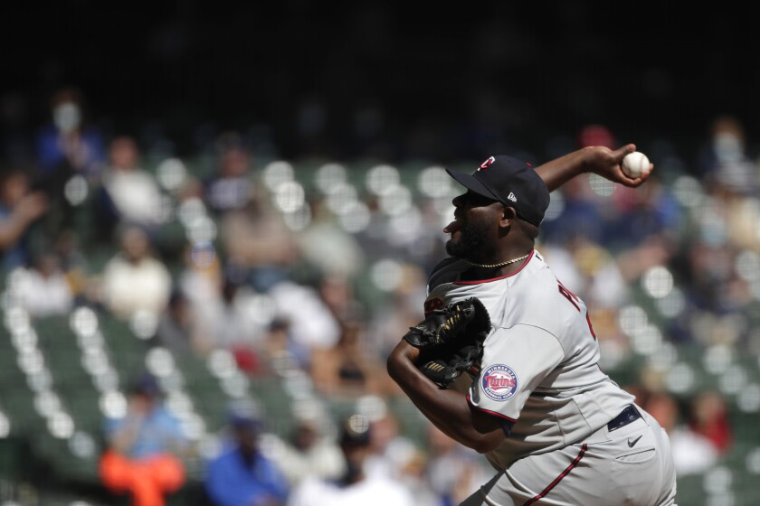 Minnesota Twins' Michael Pineda pitches during the first inning of a baseball game against the Milwaukee Brewers Sunday, April 4, 2021, in Milwaukee. (AP Photo/Aaron Gash)
