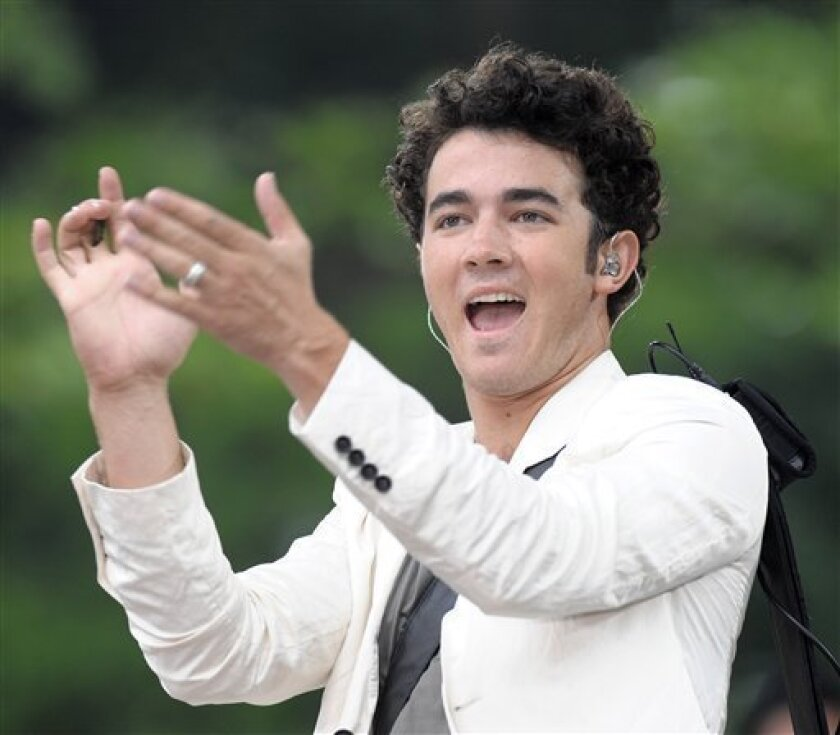 """FILE - In this June 12, 2009 file photo, musician Kevin Jonas of the music group The Jonas Brothers performs on ABC's """"Good Morning America"""" show in New York. (AP Photo/Peter Kramer, file)"""