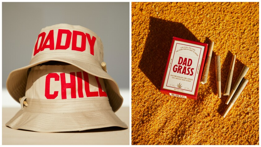 """Two beige bucket hats with red lettering that reads """"Daddy Chill"""" next to a box and five prerolled hemp joints."""