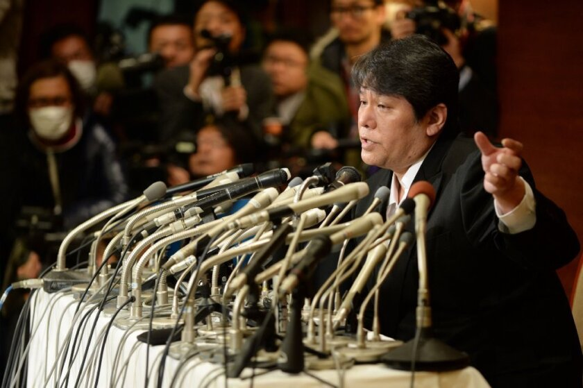 Japanese composer Mamoru Samuragochi answers questions at a news conference in Tokyo on Friday.
