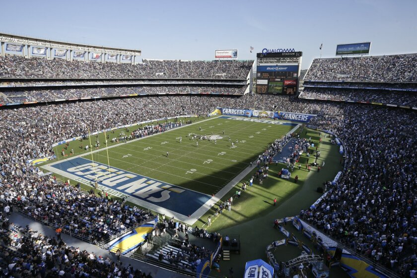 The San Diego Chargers play against the Oakland Raiders at Qualcomm Stadium in November. San Diego Mayor Kevin Faulconer announced Monday that the city is prepared to hold a Dec. 15 special election to seek voter approval to build a stadium to replace the aging stadium.