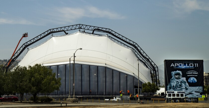 PASADENA, CA - JULY 3, 2019: Workers put finishing touches on the Lunar Dome venue which will be the