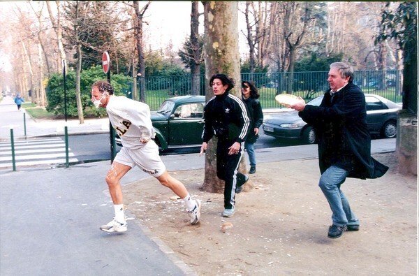 Noel Godin, right, has long sought figures he perceives as self-important as the targets of his tart-throwing. Here, Godin goes after French TV anchorman Patrick Poivre d'Arvor in Paris.