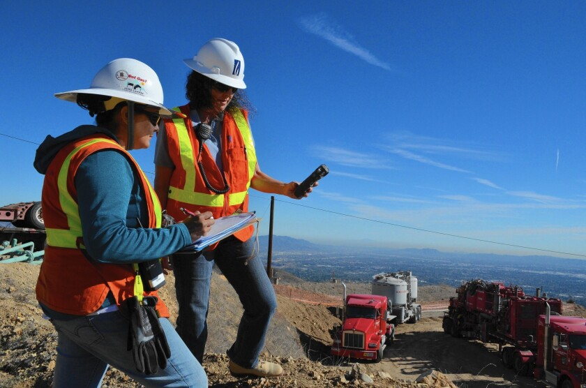 Sonia Rodriguez, left, and Bonnie Feemster take air samples to measure methane leaking from a natural gas pipe near Porter Ranch.