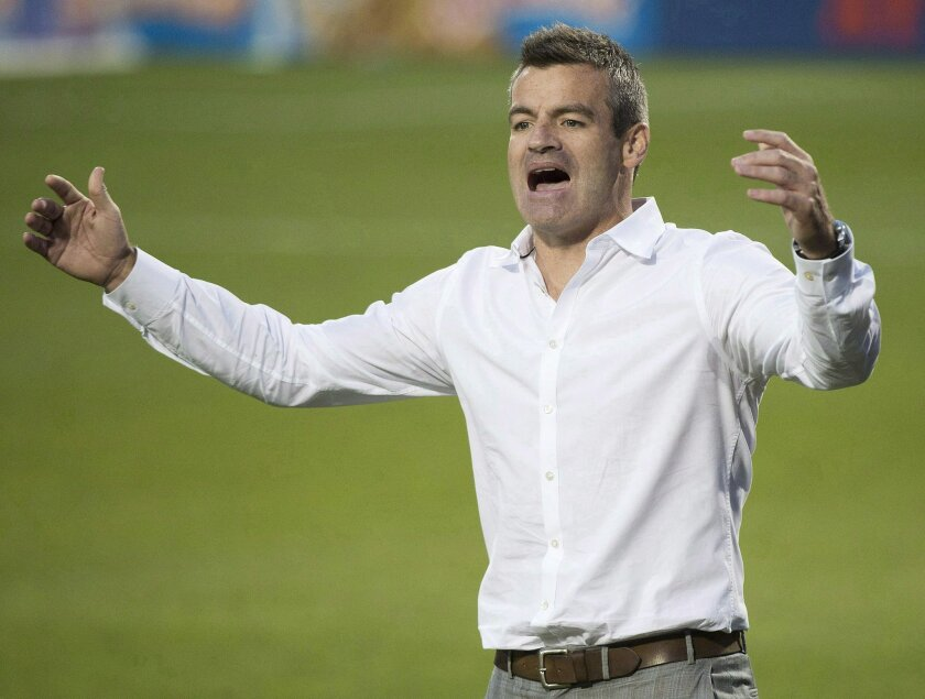 FILE - In this July 26, 2014, file photo, Toronto FC head coach Ryan Nelsen argues a call with one of the officials while playing against Sporting Kansas City during the second half of an MLS soccer game in Toronto. Toronto FC has fired Nelsen and his entire coaching staff in the wake of Nelsen's public dressing down of general manager Tim Bezbatchenko. (AP Photo/The Canadian Press, Nathan Denette, File)