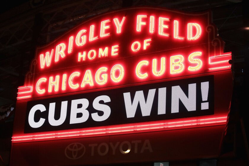 The marquee above Wrigley Field shines after the Chicago Cubs beat the Cleveland Indians, 3-2, during Game Five of the 2016 World Series on Sunday.