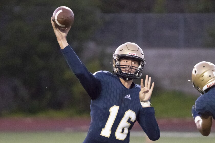 Mater Dei Catholic quarterback Trevor Appelman (shown in an earlier game) threw two touchdown passes Friday in the Crusaders' win over Olympian.