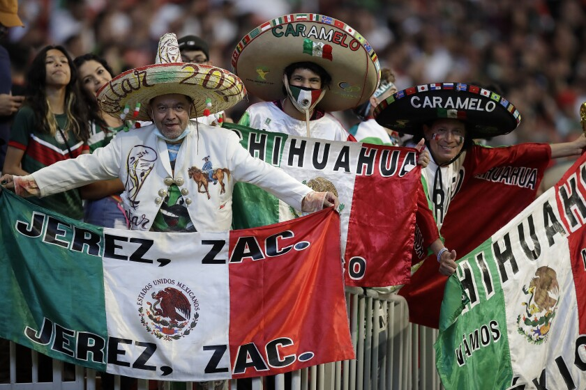 Mexican soccer fans hold flags prior to an international friendly soccer match in Atlanta