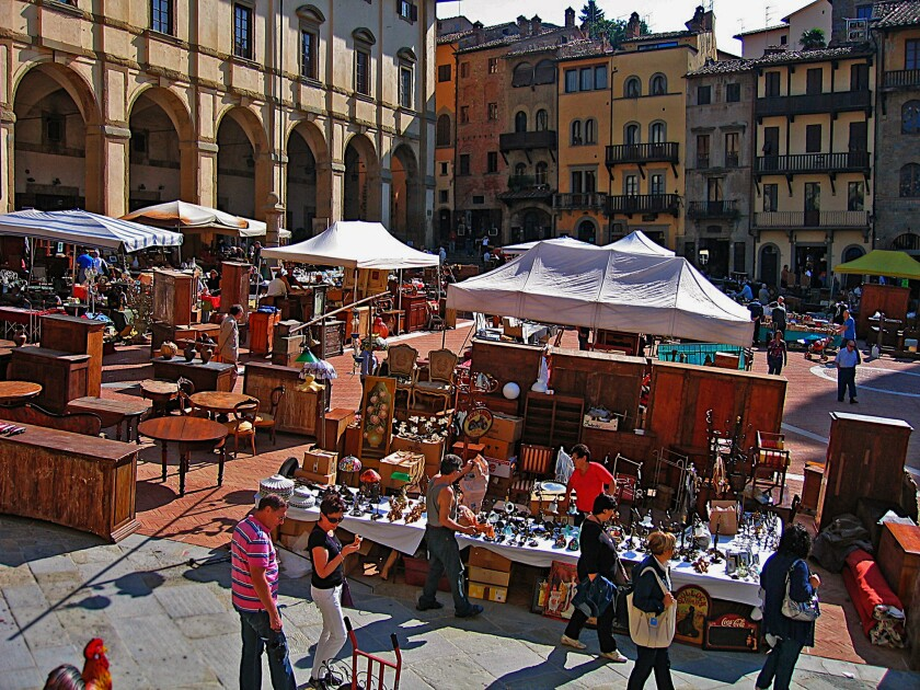 BUYER'S MARKET: Five hundred vendors display their wares in Arezzo's central square, a haven for antiques shoppers that is 40 miles from Florence, Italy.