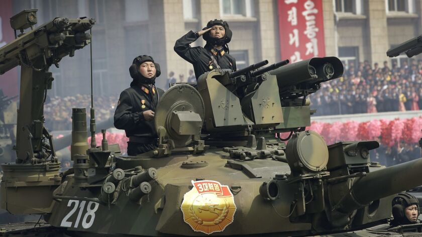Soldiers in tanks are paraded on the Kim Il Sung Square during a military parade on Saturday, April