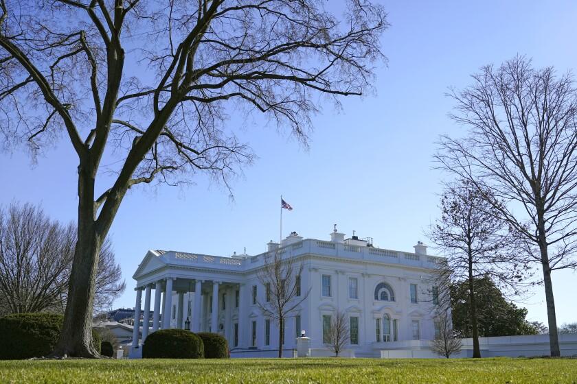 An American flag flies above the White House in Washington, Sunday, Jan. 10, 2021. (AP Photo/Patrick Semansky)