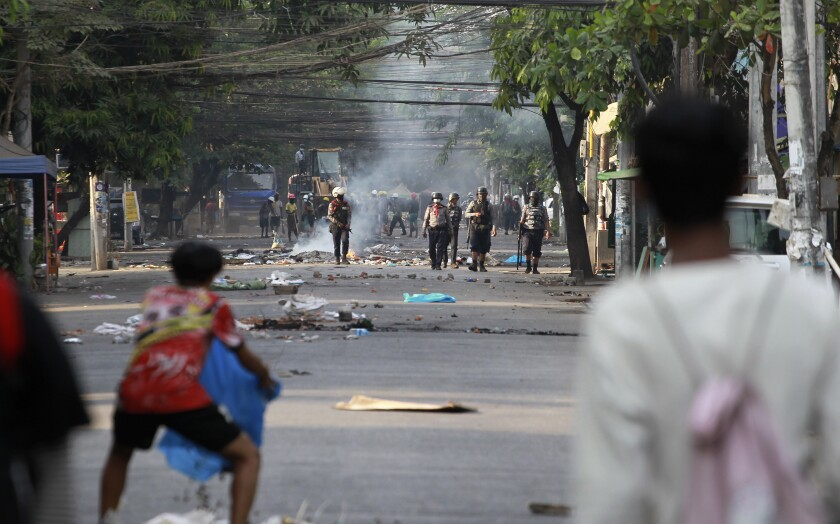 Anti-coup demonstrators prepare to confront police during a protest in Tarmwe township, Yangon, Myanmar, Thursday, April 1, 2021. (AP Photo)