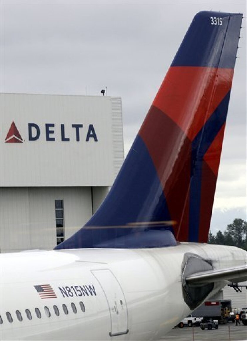 FILE - In this June 7, 2010 file photo, a Delta Airlines plane is shown at Seattle-Tacoma International Airport in Seattle. Delta flight attendants rejected the Association of Flight Attendants-CWA in election results released on Wednesday, Nov. 3, 2010. (AP Photo/Ted S. Warren, file)