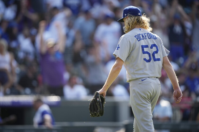 Dodgers reliever Phil Bickford heads to the dugout after giving up a walkoff home run to Colorado's Charlie Blackmon.
