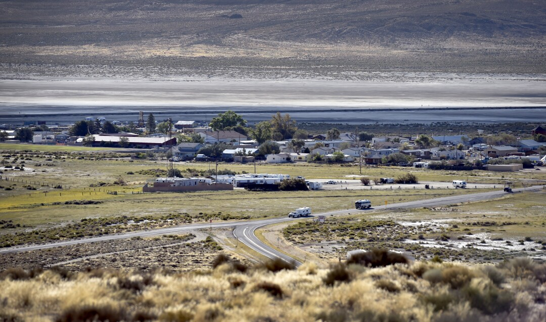 Burning Man attendees drive through Gerlach, Nevada