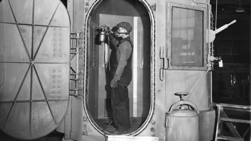 1938 file photo workman completes the installation of the new gas chamber at San Quentin. For Then a