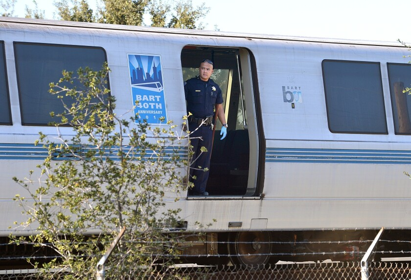 A BART police officer at the scene of a fatal incident Saturday in which a train struck and killed two workers.