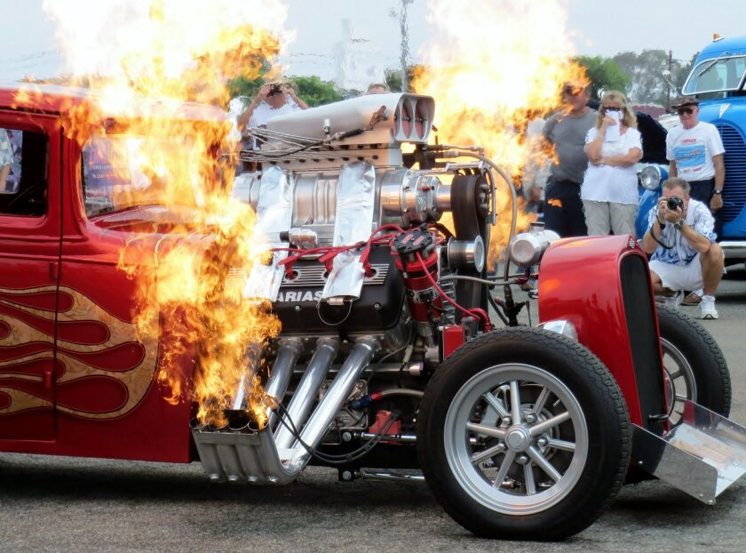 """Wild Thang"" doing its thang at the Thanksgiving In July show in Oceanside. Beneath the flames is a '31 Chevy coupe owned by hot-rod builders Phil and Mary Leatherman of Corona."