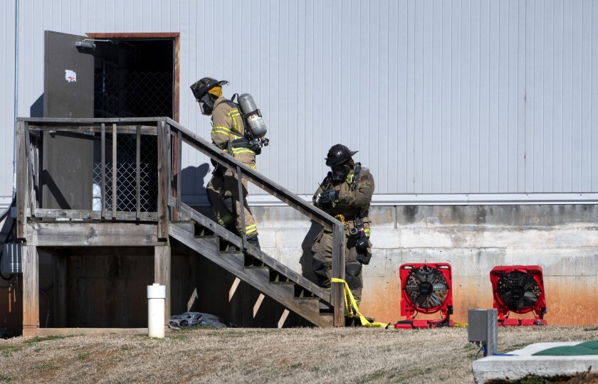 FILE - In this Jan. 29, 2021, file photo, Hall County firefighters enter a back door at Foundation Food Group in Gainesville, Ga., the day after six people were killed following a liquid nitrogen leak at the plant. The U.S. Occupational Safety and Health Administration on Friday, July 23, 2021, proposed $1 million in fines against Foundation Food Group and three other companies for workplace safety violations related to the deaths. (Scott Rogers/The Times via AP, File)