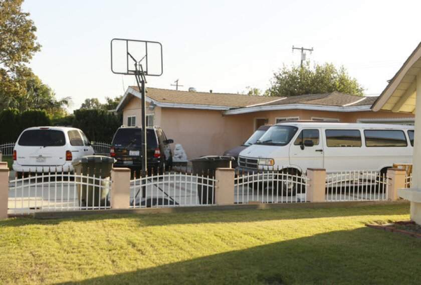 The family of Sinh Vinh Ngo Nguyen, accused of aiding Al Qaeda, expressed shock at the allegations. Above, the family's home in Garden Grove.