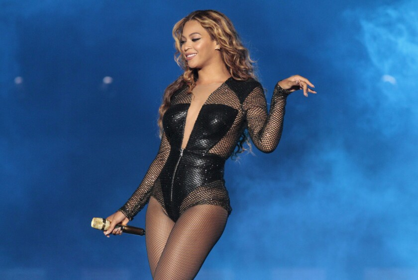 "Beyonce performs during her ""On the Run"" tour with husband Jay Z at the Rose Bowl in Pasadena on Aug. 2, 2014."