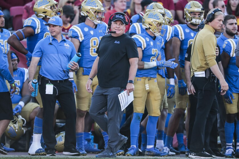 UCLA coach Chip Kelly looks on from the sideline as the Bruins play USC.