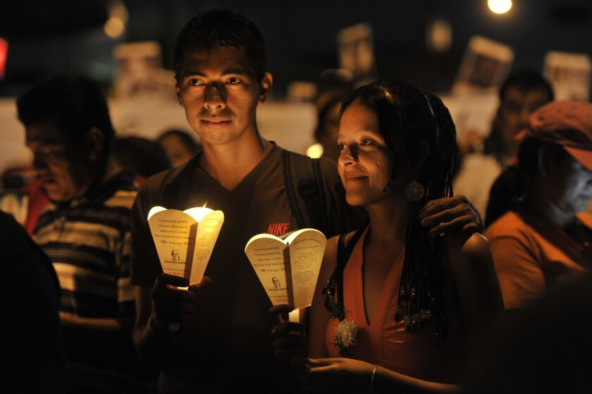 Roman Catholics take part in a pilgrimage of light in San Salvador on Saturday, part of the acts to commemorate the 35th anniversary of the assassination of Archbishop Oscar Romero.
